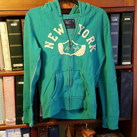 Women's small american eagle zip up hoodie Women's small green American Eagle zip up hoodie, in great condition, no rips, stains, holes, etc American Eagle Outfitters Tops Sweatshirts & Hoodies