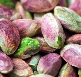 pistachios.....close up views of natural elements like nuts, seeds, pollen, shells, leaves......can help me choose color combinations for painting and inking on my pages