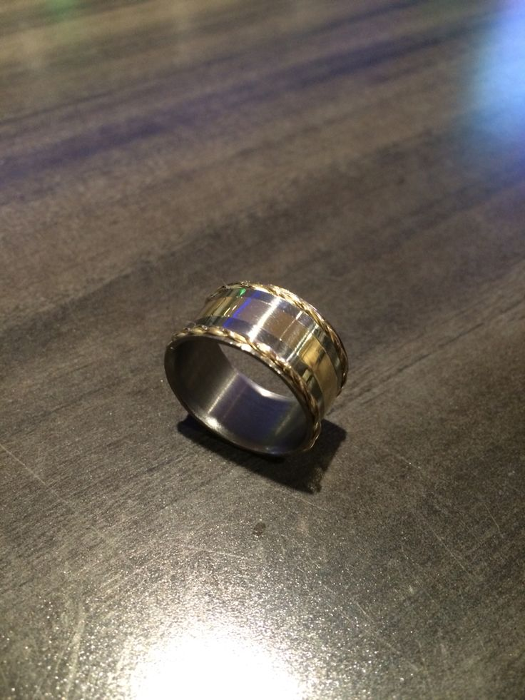 Titanium and 10k gold band ring. Cast in place 10k gold channel and twisted 10k gold wire rims, titanium was cut using a metal lathe. For sale!