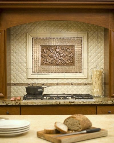 Relief tiles - those with a raised design - add texture and dimension to your backsplash, creating a mural that pops off the wall. #kitchen #backsplash