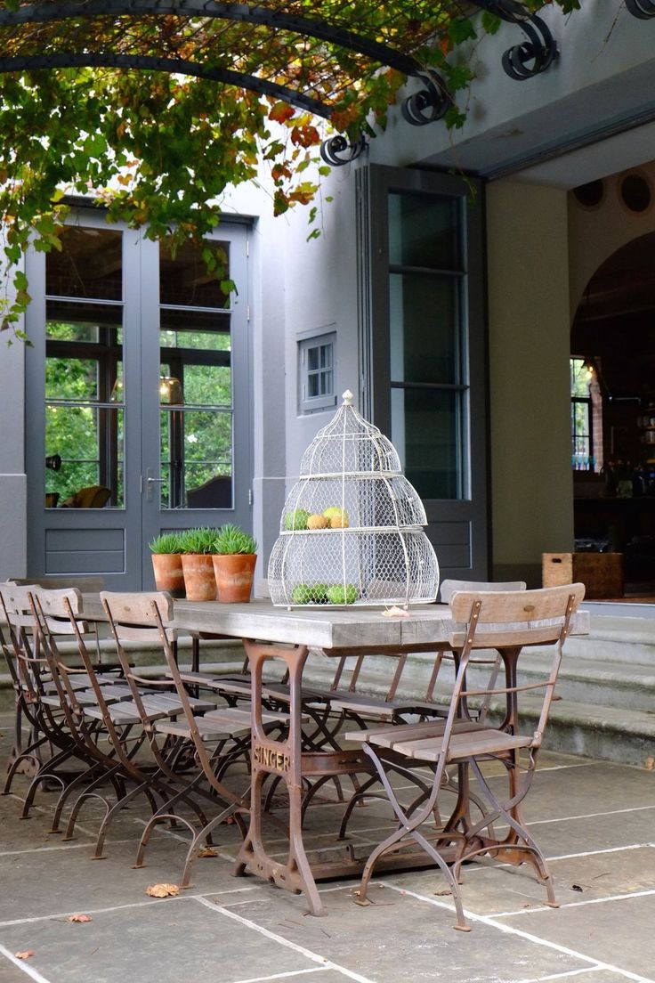 Two Singer sewing machine stands used as trestles for outdoor table.  Karen & Gawie's Artistic Home in South Africa