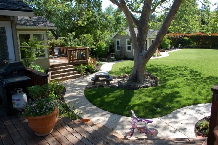 """Trike Path """"Trike-Track."""" We positioned this curvy, circular path within view of the kitchen window so we could keep a watchful eye while still getting things done."""