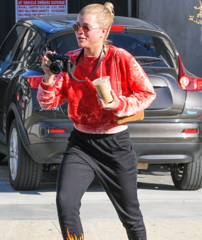 RED HOT   Model Sofia Richie runs to capture a moment on camera while out and about in L.A. on Thursday. Star Tracks: Friday, Jan. 27, 2017