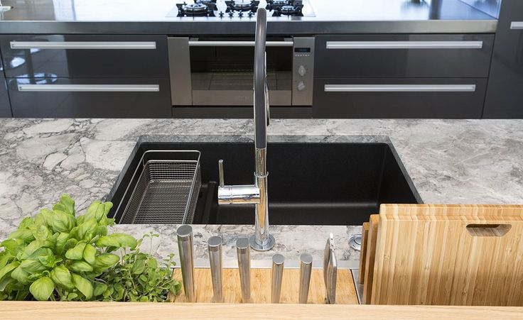 Lowered stone bench top with black granite sink