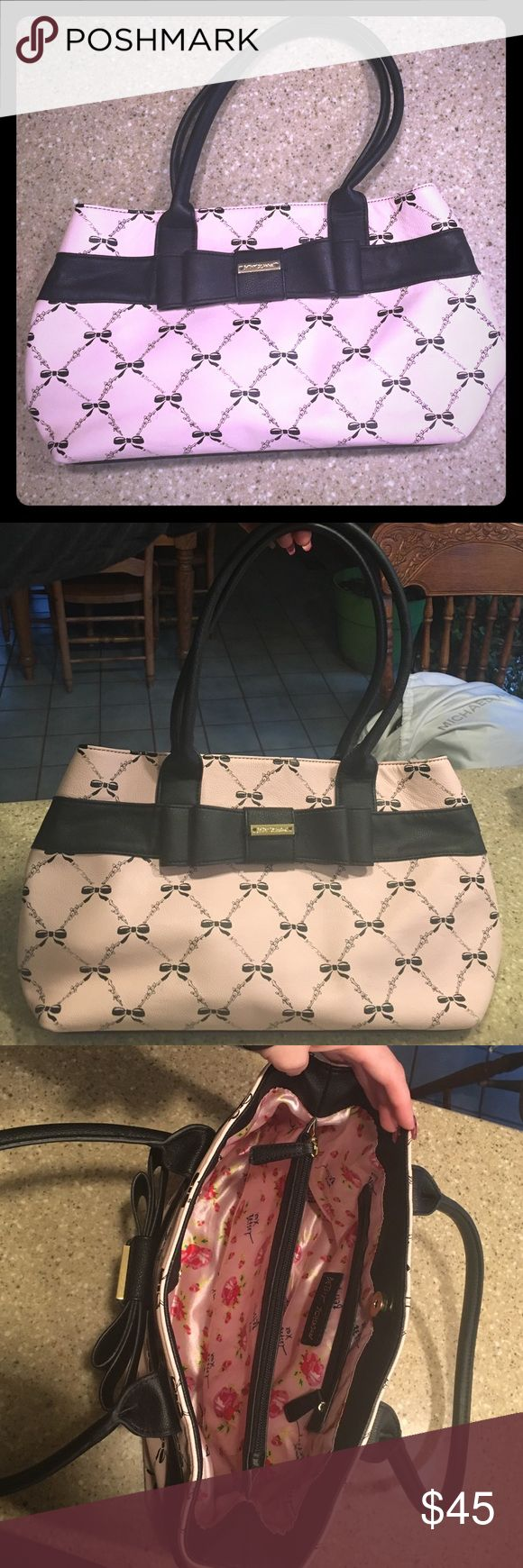 Betsey Johnson black bow, pink purse. Cute medium sized bag used a few times. Large black bow in the front with a gold Betsey Johnson embellishment. Betsey Johnson Bags