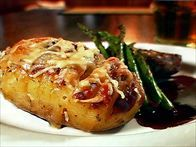 Get this all-star, easy-to-follow Three Cheese Hasselback Potatoes recipe from Robert Irvine