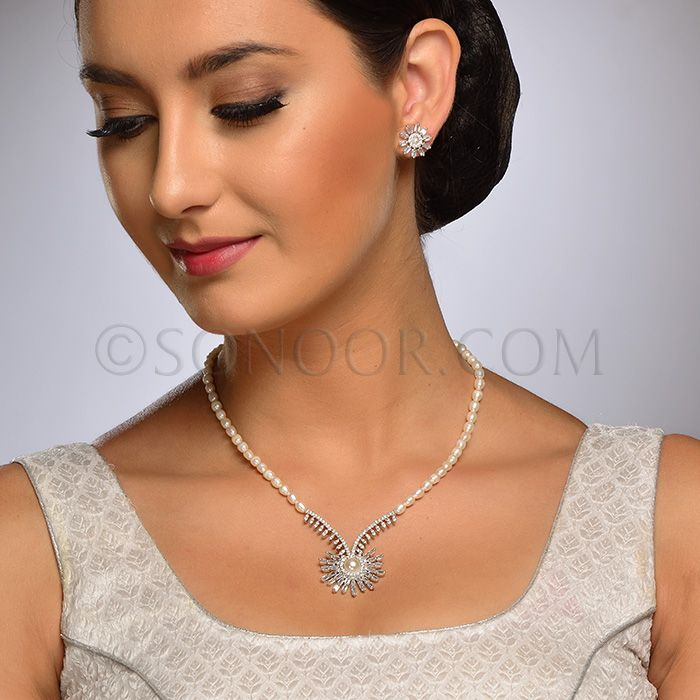 PEN/1/3713 Neelee Pendant Set with Earrings in silver rhodium finish studded with cubic zircons and begets stringing in fresh water pearls