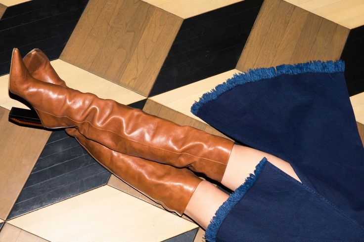 Inside Finery Founder Whitney Casey's Closet: When someone has as much energy and personality as Casey does, they usually have a wardrobe to match, which was exactly the case when we finally dug into the goods in her bedroom-sized-by-NYC-standards closet. -- Tan Thigh high boots  |  coveteur.com