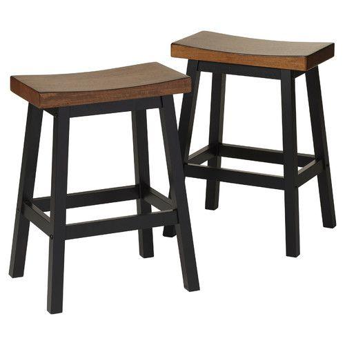 Features:  -Solid hardwood construction.  -Contoured seat.  -Saddle barstool…