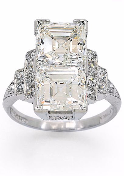 A Twin-Stone Diamond and Platinum Ring, O.B. Allan, circa 1925, Vertically set with a pair of square emerald-cut diamonds, together weighing approximately 4.20 carats, to stepped shoulders accented by small old European-cut diamonds, mounted in platinum