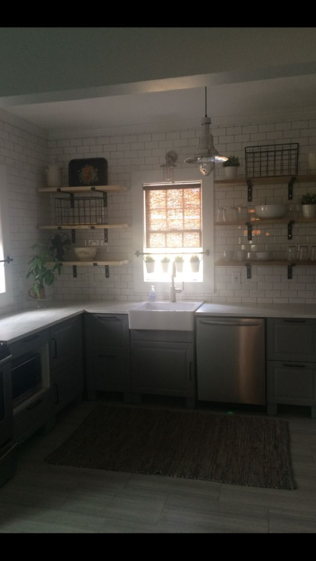 Natural poplar wood shelves, IKEA counters on a budget, IKEA cabinets, IKEA blinds, IKEA dishes and glasses, family treasures, simple subway tile and IKEA apron sink make this a timeless affordable kitchen remodel! DIY feel good!!! #remodelingdiy