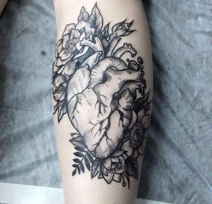 Anatomical heart tattoo with flowers. Black and grey