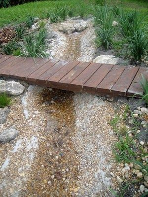 Pebble stream and bridge for the kids near their play structure.... I wish I had the space for this!
