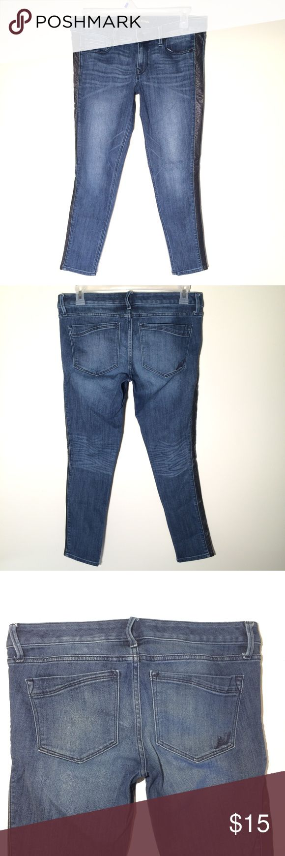 """EXPRESS STELLA ANKLE LEGGING STRETCH JEANS 10 EXPRESS BRAND LOW RISE ANKLE LEGGING STRETCH JEANS. Ladies Stella size on tag is 10R. Faux leather insert down each leg. Excellent condition with no rips stains or tears. 75% cotton 24% polyester and 1% spandex. Zip fly. Please check actual measurements below.   ACTUAL MEASUREMENTS  Waist 34"""" Inseam 28.5"""" Rise 9"""" Hips 36"""" Leg opening 10"""" Express Jeans Skinny"""