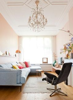 How to Decorate with Pantone's Rose Quartz and Serenity - soft pink walls and a light blue sofa.