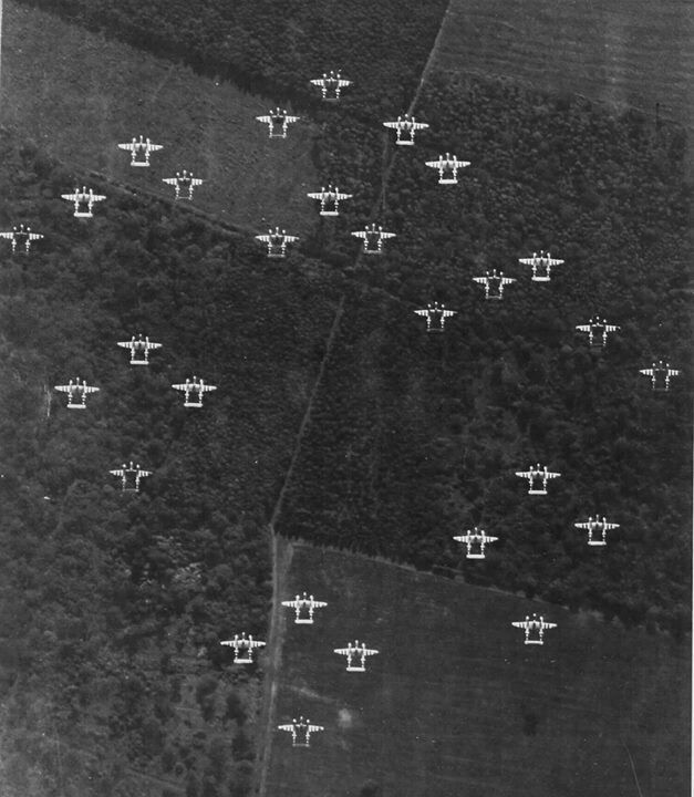 A formation of P-38 Lightning aircraft of the 20th Fighter Group over France, June 1944.