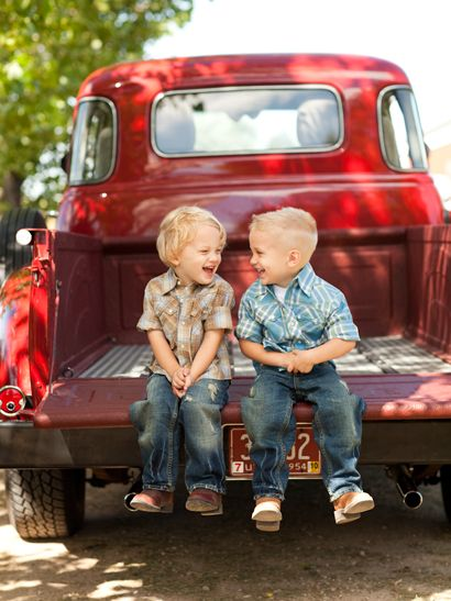 towhead twins in blue jeans and a red pickup