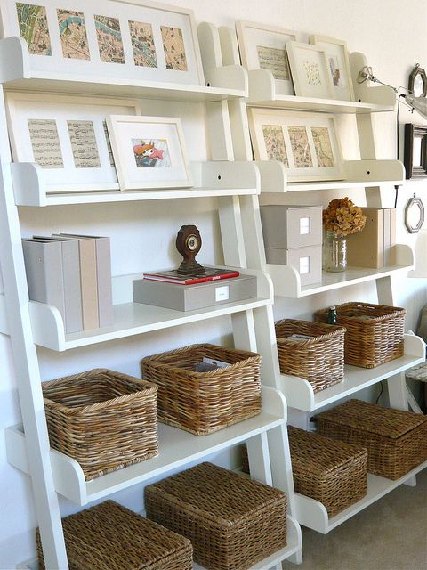 baskets and horizontal frames to make the office shelves look nicer?