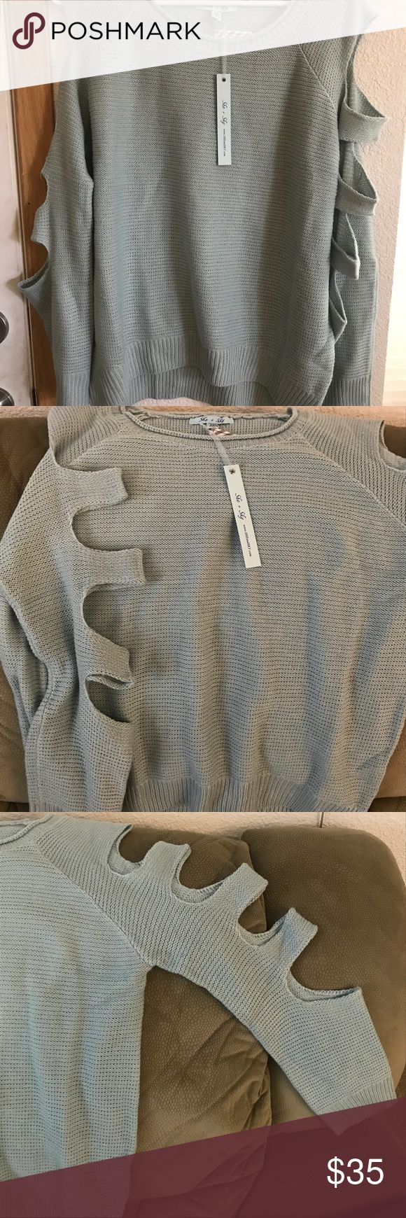 Knit sweater with cut out sleeves NWT Aqua green sweater with cut or sleeve. Super comfy and BRAND NEW! Brand is She + Sky, but was purchased from Sea Salt and Honey Boutique. I offer bundle discounts! She and Sky Sweaters