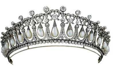 Cambridge Lovers Knot Tiara: Queen Mary, wife of King George V, commissioned royal jewelers Garrard's to create this tiara in 1913. Its 19 openwork diamond frames each feature a large drop-shaped pearl hanging from a lovers'-knot bow. Queen Mary bequeathed the tiara to her granddaughter Queen Elizabeth, who in turn gave it to Princess Diana as a wedding present in 1981. Following her divorce from Prince Charles in 1996, Diana returned it to the Queen.