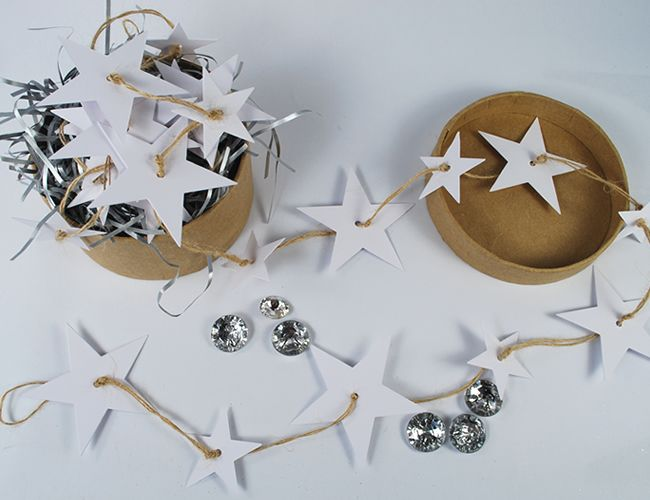 How to make a simple star garland from plain white card and button twine.