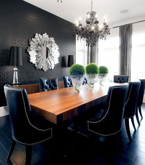 Dark wallpaper feature wall in a dining room with a dark floor finish