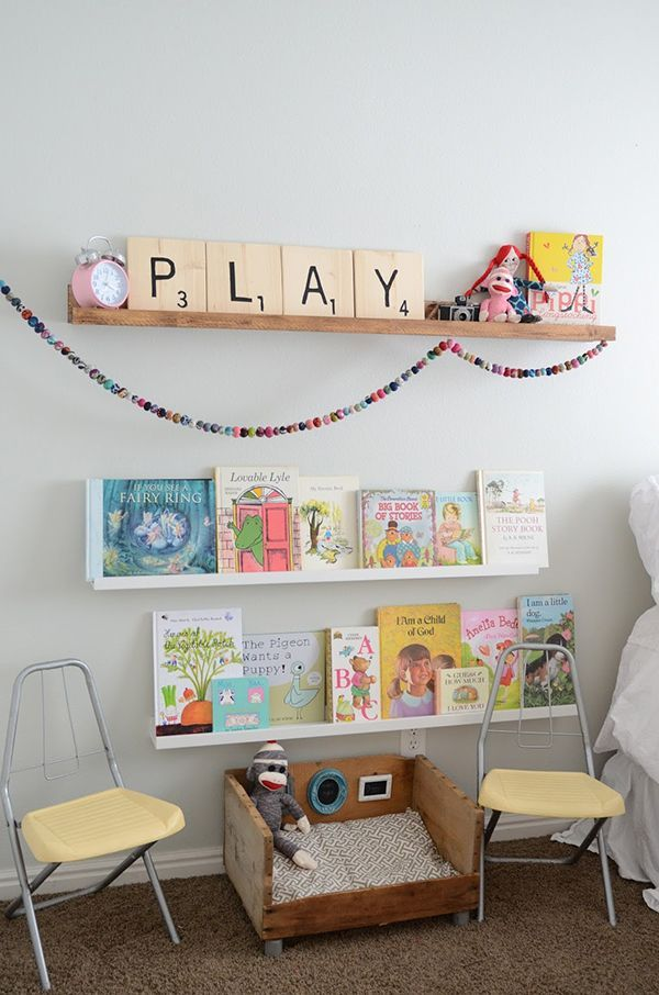 Colourful Little Girls Bedroom and innovative way to display books and a little dolls bed