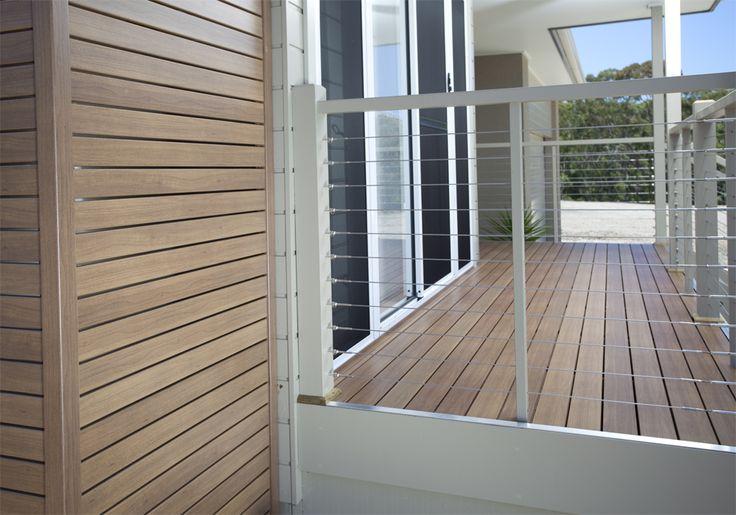 DecoDeck Kwila. Naturally beautiful Australian made, Super Durable, low maintenance decking. Timber look aluminium. Matching DecoSlat privacy screen. #decodeck #deck #decking #kwila #timber #aluminium #screen #privacyscreen #patioscreen