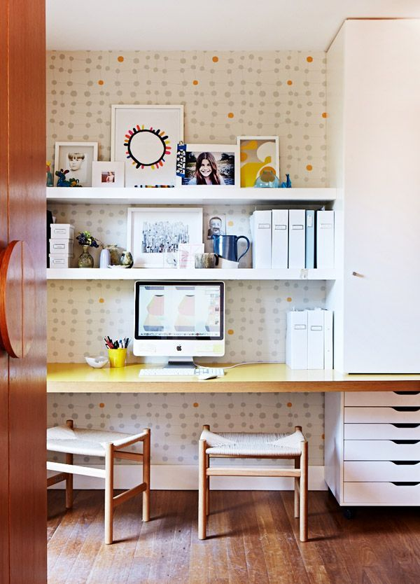 tidy workspace with wallpaper and open shelving