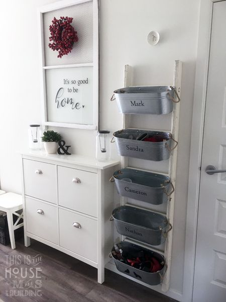 mudroom bins and ikea shoe cabinet with new handles