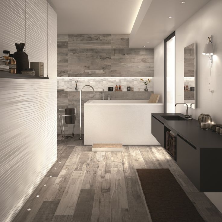 Il calore dell'effetto legno di DOLPHIN Grey esaltato dalle scenografiche #pareti #3D realizzate con DO UP TOUCH Base e Feel White matt e con il Mosaico Dynamic White glossy, tutto #abkemozioni. #ceramic #tiles #floor #wall #wallandporcelain #gres #porcellanato #decor #interiordesign #homedesign