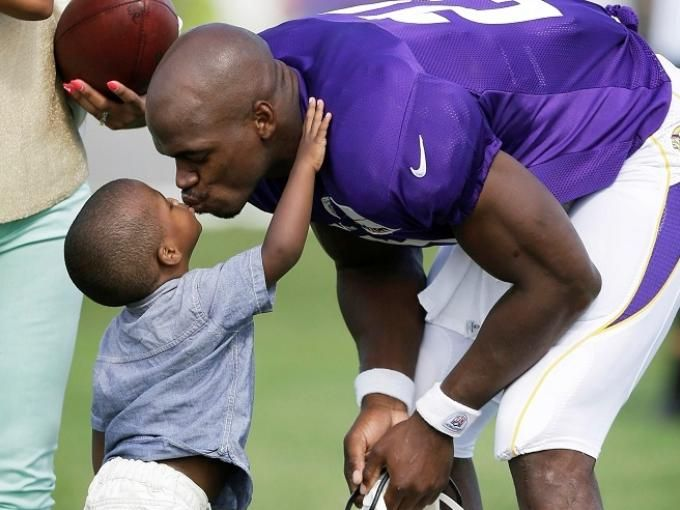 Adrian Peterson and his son