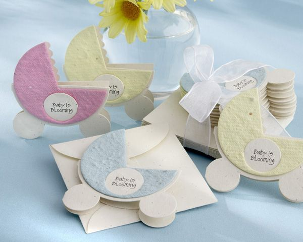 The 'Baby is Blooming' carriage above looks like a normal card or piece of paper.  However, it is actually a template made with wildflower seeds.  The shower guests can take this favor home and plant it. The pram comes in a lovely cream colored envelope.  This great favor is available from Avannabel Baby.