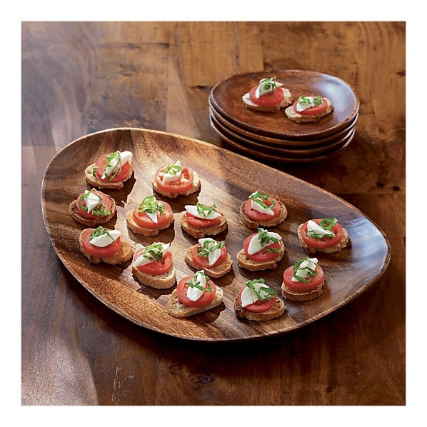"""Wooden platters for entertaining; unbreakable, and useful. Can always be covered with a colourful cloth napkin to """"fancy up"""" for celebrations."""