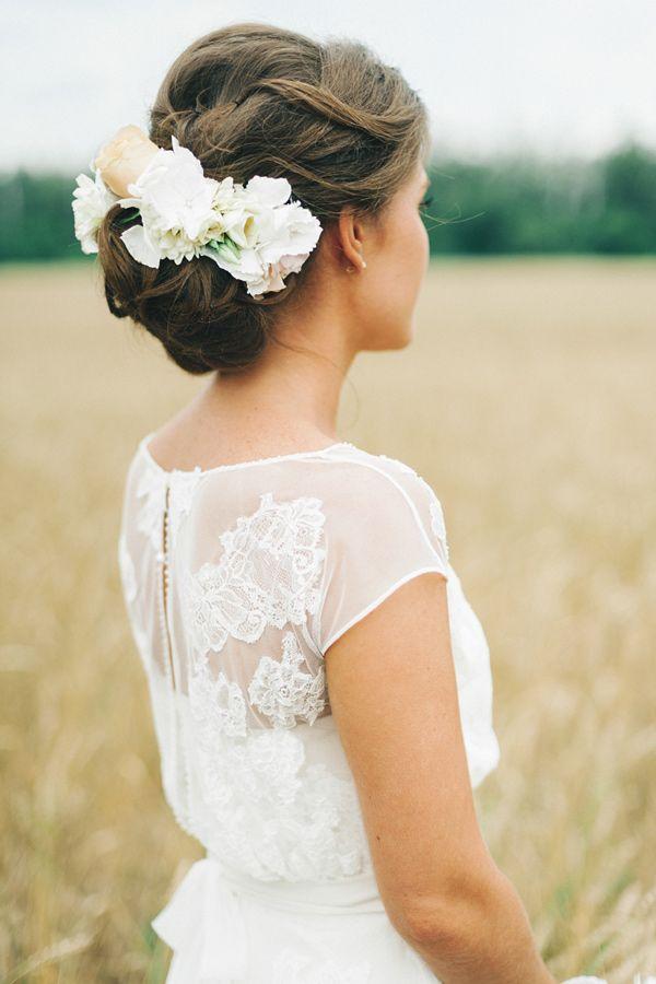 floral hair accessory - photo by Maria Levitska http://ruffledblog.com/intimate-russian-wedding