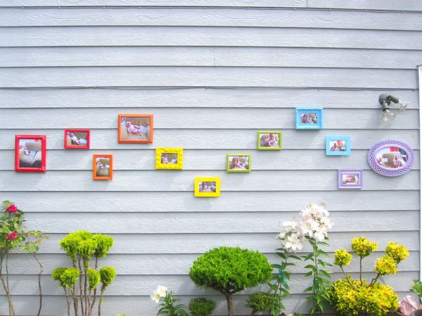 use  spray paint to add some color to a collection of super cheap frames. idea: display her monthly photo series