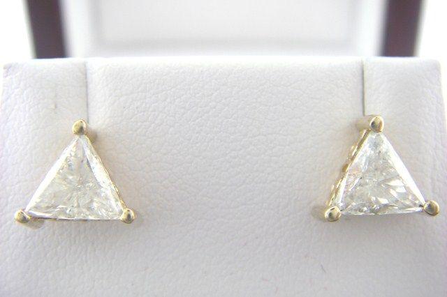 Trillion diamond earrings in gold setting. Screw back style studs. 1 carat each. Eye clean. Great cut