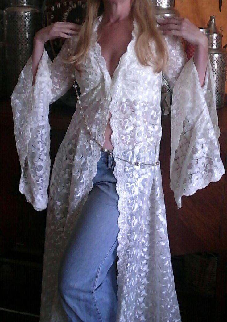 Lace Bell sleeved coat with ripped jeans and halter bra, ask by ecofriendzy