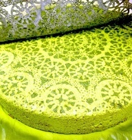 Using paper doilies spray paint stepping stone or table top