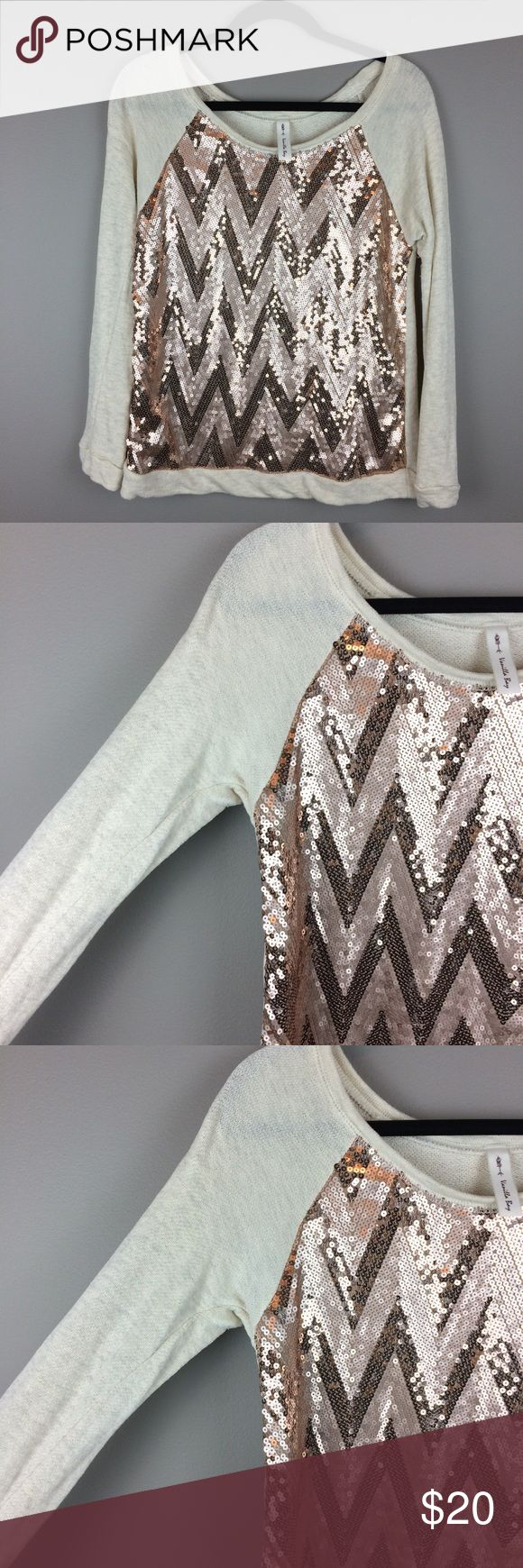 Rose gold Chevron Sequin slouchy sweatshirt top Condition: Preowned, no holes or stains. Great condition   Color: heathered cream and rose gold sequins  Measurements: Listing as a size medium- tags have been removed- measures like a medium- please read to determine and compare measurements to something you already own. Underarm to underarm is approximately 17 1/2 inches across.  Length from back of neck to bottom of hem is approximately 21 inches. Tops Sweatshirts & Hoodies