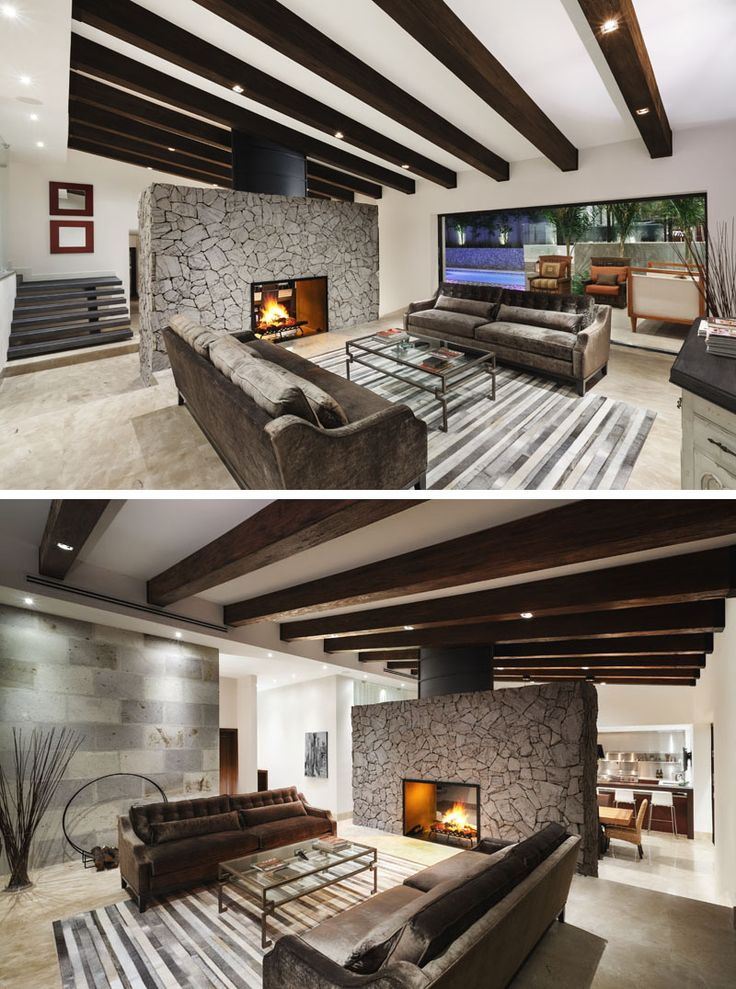 This modern renovated house now features a bright open interior with a large stone fireplace that can be enjoyed from the living room or the dining room. The living room opens up to the terrace outside, and creates an indoor/outdoor living environment, perfect for entertaining. Wood beams were installed to protect the structural integrity of the roof, and to add new lighting.