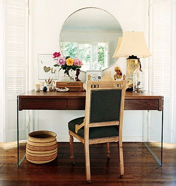 My absolute favorite. Love the heavy wood floating table on acrylic legs.