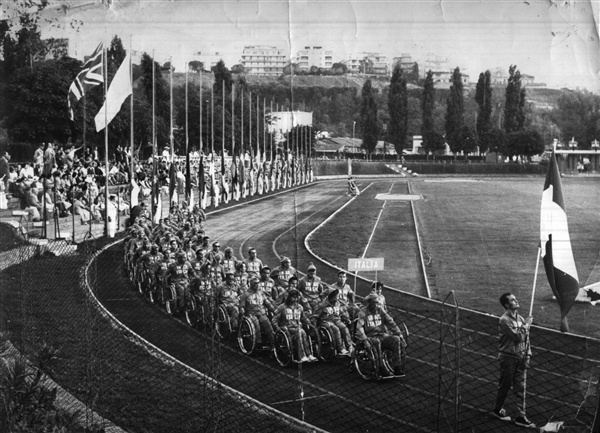 International Paralympic CommitteeCompetitors roll into the opening ceremonies of the first Paralympics, held in Rome in 1960.