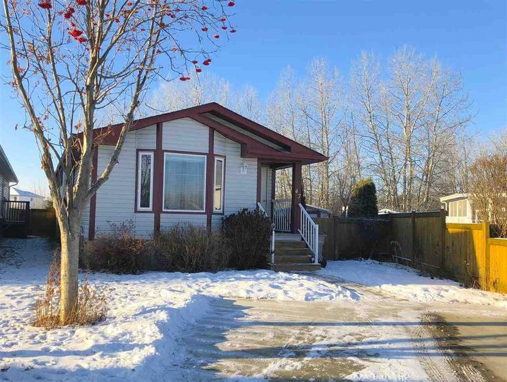 2 bedroom Mobile Home on Large Pie Lot backing trees and a creek. Owned Land!!!