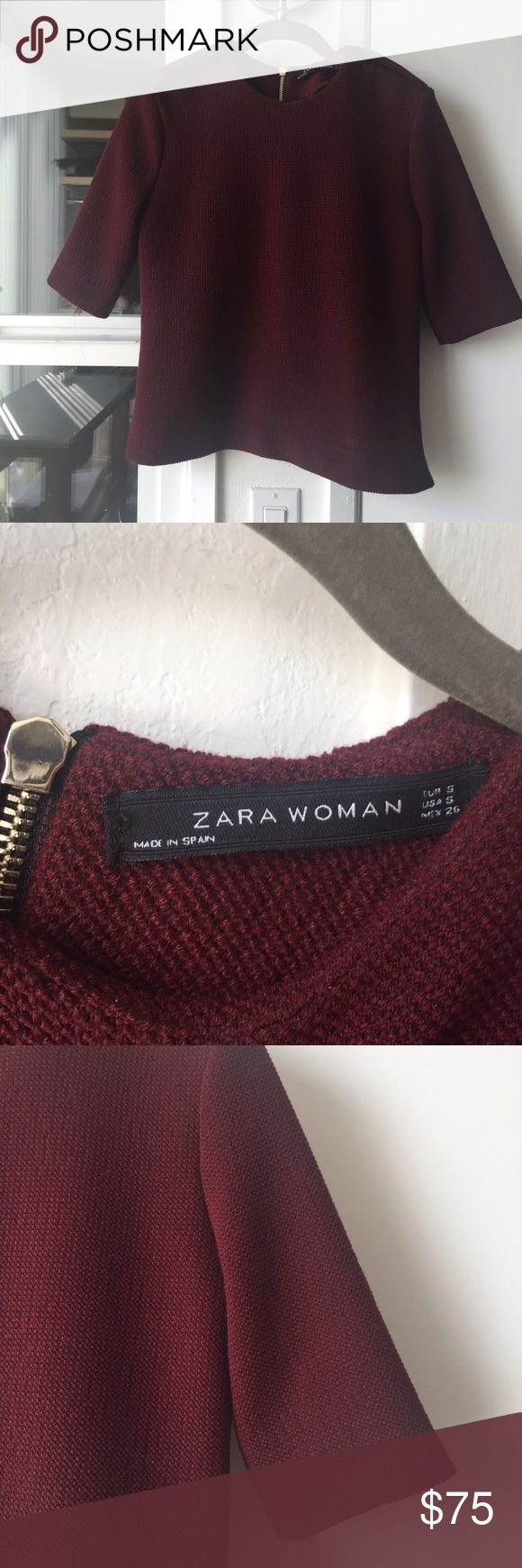 ZARA structured top, S Fits 2-4.  Excellent condition.  Epaulettes on shoulders.  Modern classic.  Burgundy.  See their listing for navy blue.  Easy care: machine wash cold.  Longer sleeves hit about an inch above my elbow.  I am more of 4-6, too tight for me now. Zara Tops Blouses