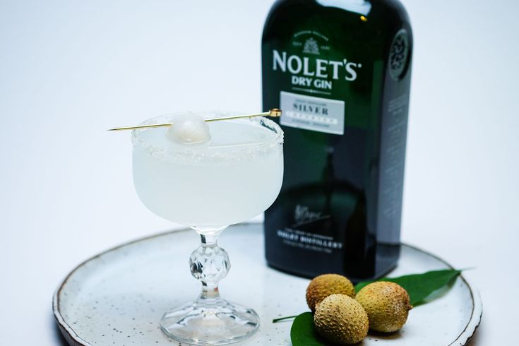 1 oz. NOLET'S Silver Gin 1 oz. Lychee Syrup Dash of Fresh Lemon Juice Club Soda Shake NOLET'S Silver, lychee syrup and lemon juice with ice in a cocktail shaker. Pour ingredients into an empty rocks glass. Top with ice and a splash of club soda.