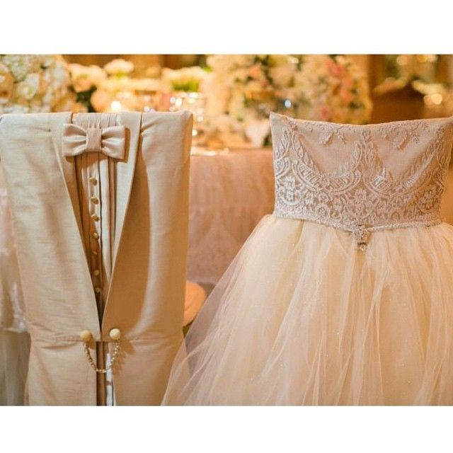 nigerianwedding:  His & hers bridal attire inspired chair covers, how cute? Covers by @wildflowerlinen ! #NWdecors #NigerianWedding #Chaircovers