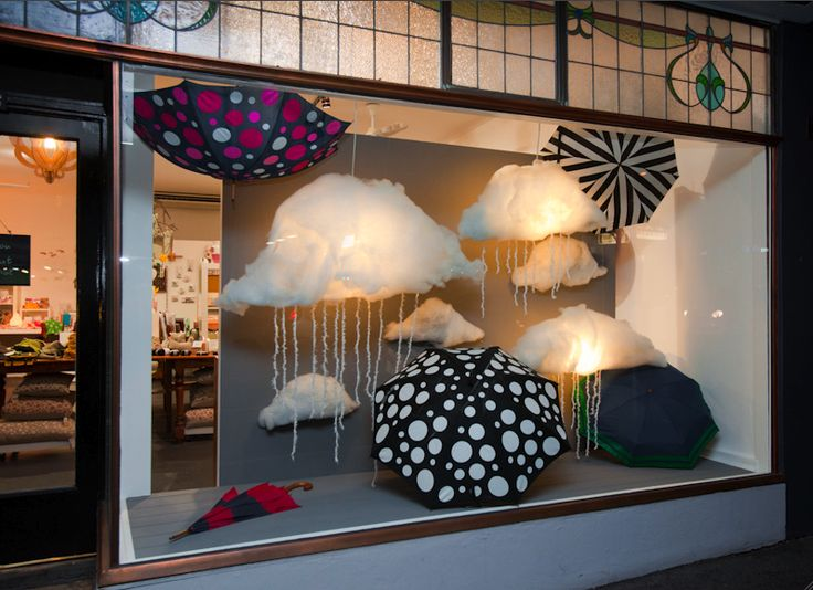 """truly playful window display of GINA & MAY umbrellas from Melbourne store """"Lily & The Weasel""""!"""