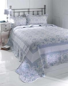 pale blue quilt and pillow shams