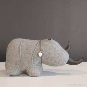This Adorable Wool + Leather Door Stop Rhino Doubles As A Book End. How Cute